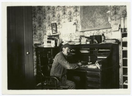 man-writing-at-desk